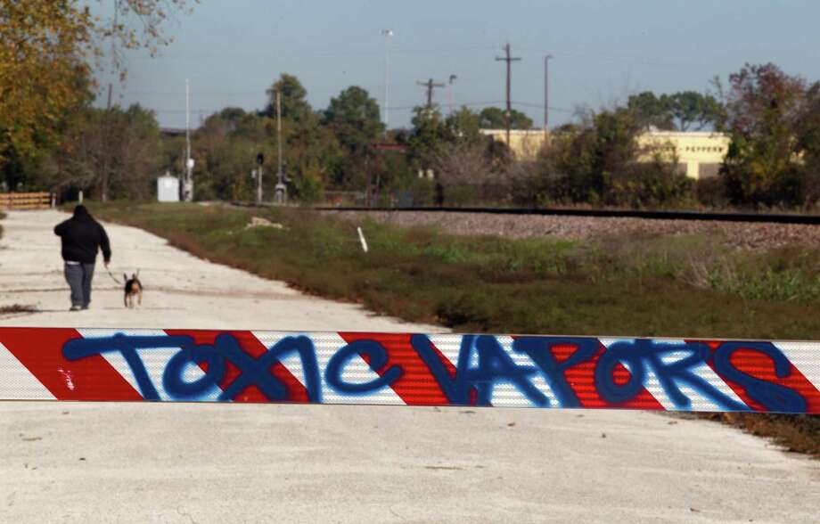 Graffiti marks a barrier on Cavalcade near a former wood treatment facility that was declared a Superfund site in 1984. Photo: J. Patric Schneider, Freelance / © 2013 Houston Chronicle
