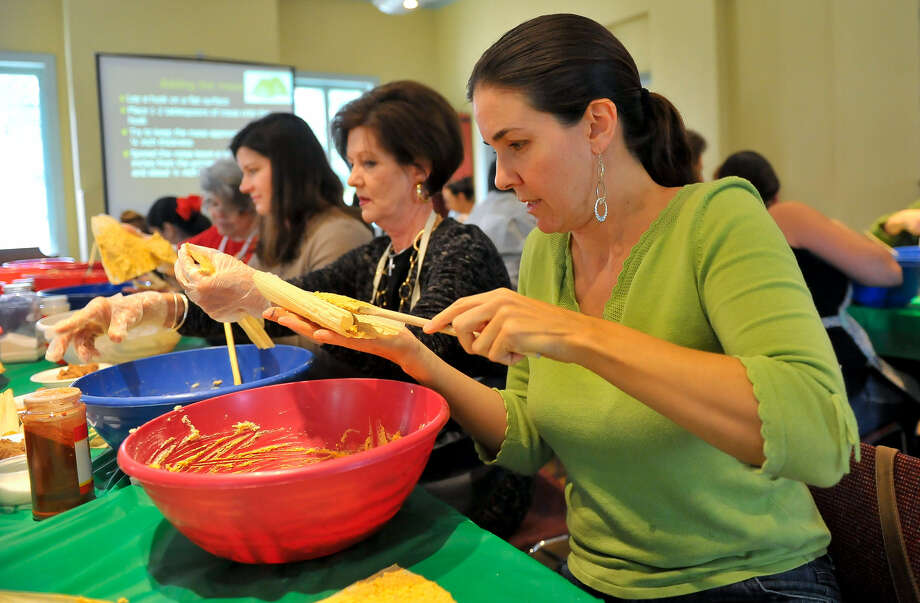 Darci Burchers (from left), Cathy Owen and Joanna Ciccarello fill tamales during a tamalada at the Witte Museum. Photo: Robin Jerstad / For The Express-News