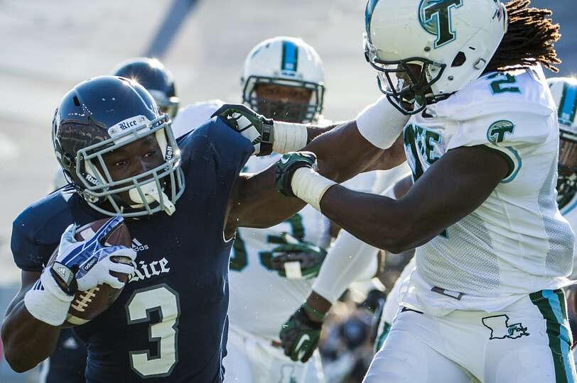 Rice running back Jawon Davis gets past Tulane safety Darion Monroe as he scores on a 16-yard touchd