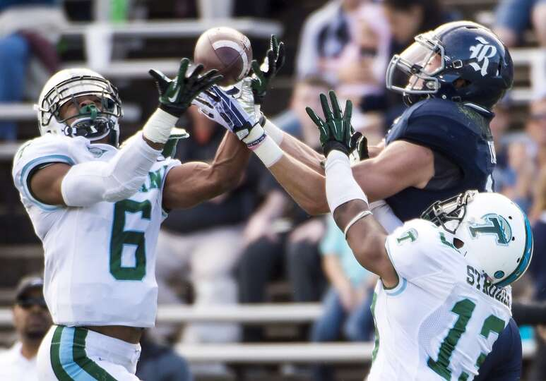 Tulane cornerback Lorenzo Doss and Derrick Strozier break up a pass inteded for Rice wide receiver D
