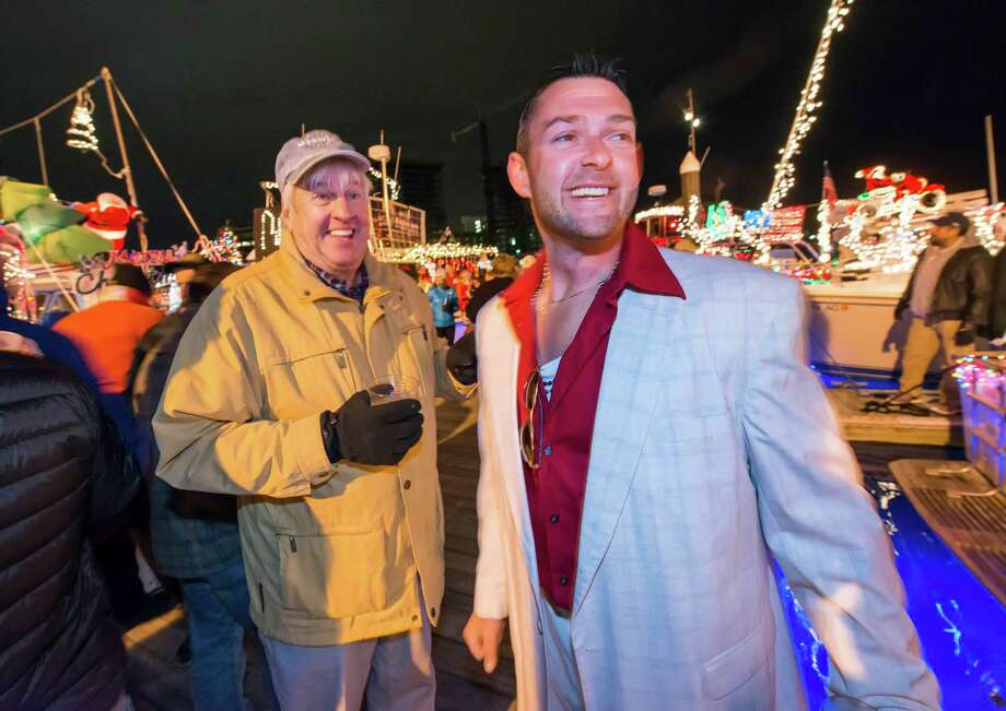 On the docks next to the Crab Shell restaurant, Stamford, CT John Richy (right) shows Dick Gildersleeve the boat he entered in this years Thanksgiving weekend Stamford Harbor Parade of Lights. Photo: Mark Conrad / Connecticut Post Freelance