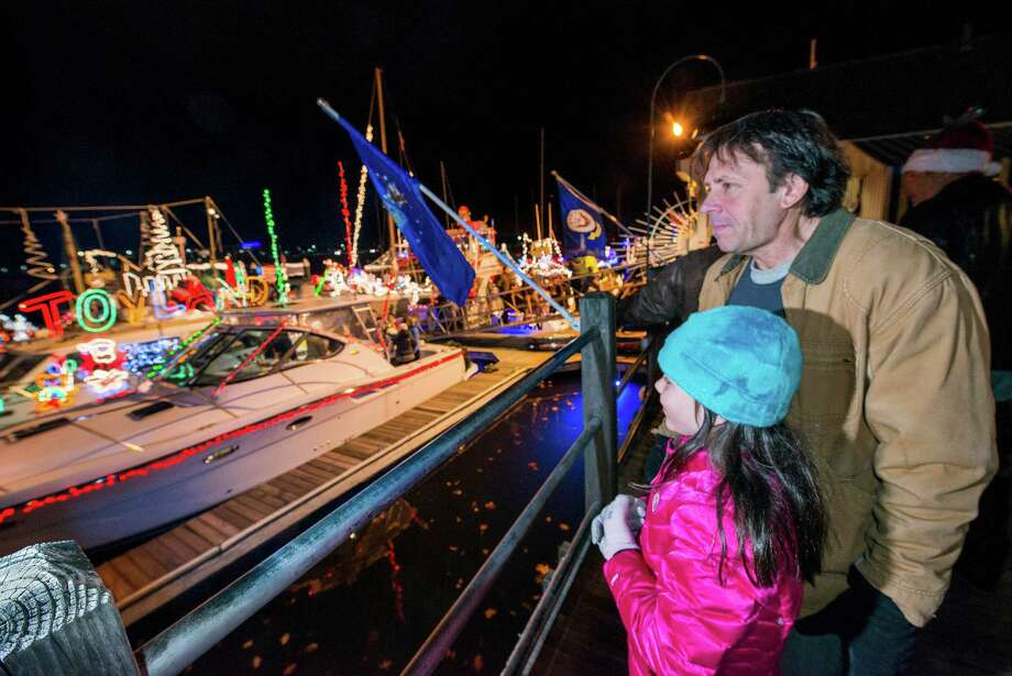 Art and Audrey Sears look at the boats that participated in the annual Thanksgiving weekend Stamford Harbor Parade of Lights docked next to the Crab Shell restaurant, Stamford, CT on Saturday, November, 30th, 2013. Photo: Mark Conrad / Connecticut Post Freelance