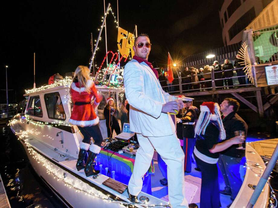"On the docks next to the Crab Shell restaurant, Stamford, CT John Richy and crew have a some fun on the boat he entered in this years Thanksgiving weekend Stamford Harbor Parade of Lights. The theme of his boat was ""Studio 54"" Photo: Mark Conrad / Connecticut Post Freelance"