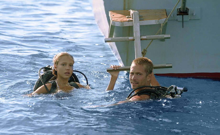 "In this photo provided by Columbia Pictures,  Sam (Jessica Alba) and  Jared (Paul Walker) are  divers that discover a legendary shipwreck rumored to contain millions in gold at the bottom of the sea in "" Into the Blue."" Photo: JOHN P. JOHNSON, AP / COLUMBIA PICTURES"
