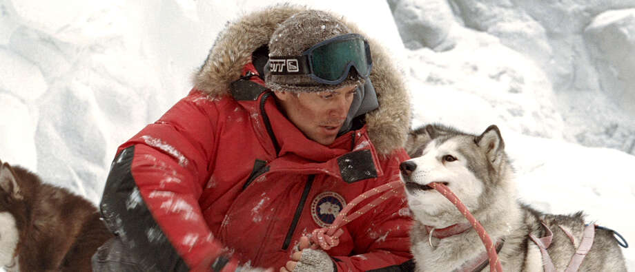 "Gerry Shepherd (Paul Walker) is forced  to leave his team of sled dogs behind,  as the team  fend for their survival, in ""Eight Below."" Photo: AP / WALT DISNEY PICTURES"