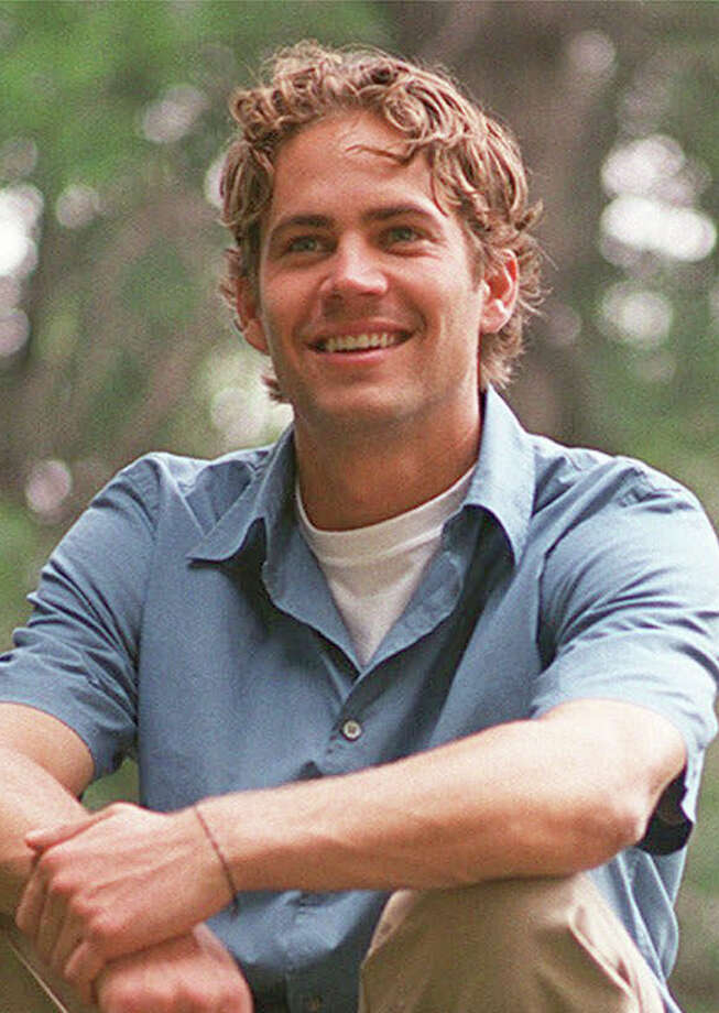 "Actor Paul Walker poses in New York's Central Park, in this June 13, 2001 file photo. Walker said he was angry when Vin Diesel, his co-star in ""The Fast and the Furious,'' pulled out of the sequel, ""2 Fast 2 Furious.'' ""I thought we were partners. It hurt my feelings,'' Walker told Teen People magazine for its May 2003 issue. ""But once I stepped back, I realized that I couldn't take it personally - it's all about business.'' Photo: JIM COOPER, AP / AP"