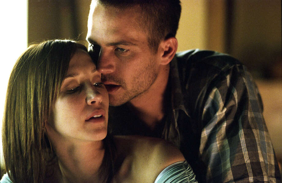In this photo provided by NewLine Cinema, Teresa Gazelle  (Vera Farmiga)  with her mob husband, Joey Gazelle (Paul Walker) are in danger from the mob in  'Running Scared.' Photo: LARRY HORRICKS, AP / NEWLINE