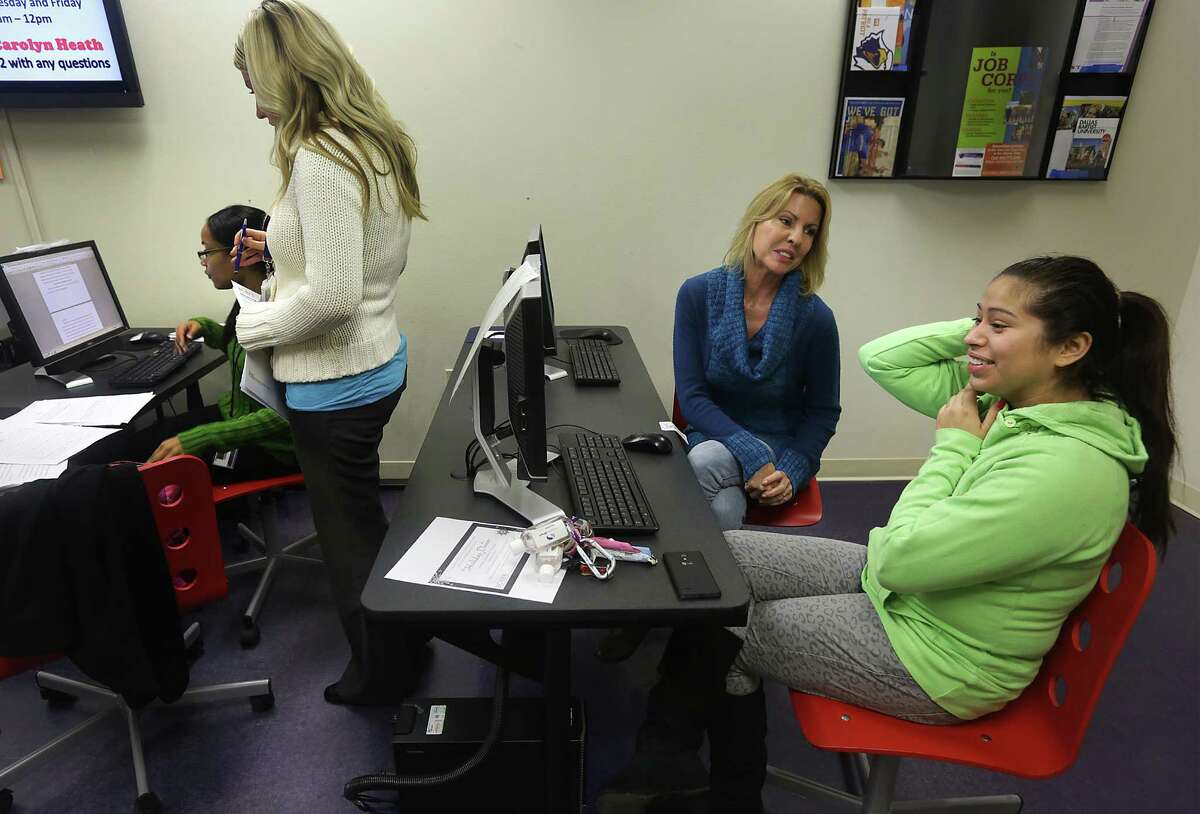 Elaine Hartle, second from right, Director of THRU Project, helps Jessica Urias, right, 19, with an online application form, at PAL Aftercare. Monday, Nov. 25, 2013. Stacy Lee, second from left, BCFS Program Director of PAL Aftercare, assists Jessica Francis with a questionaire.