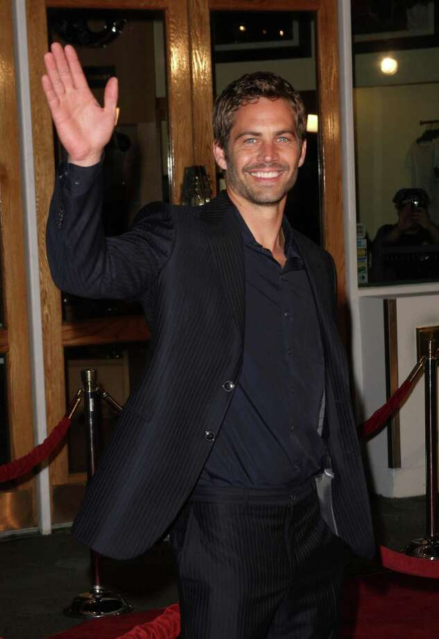 """Actor Paul Walker arrives at the premiere Universal's """"Fast & Furious"""" held at  Universal CityWalk Theaters on March 12, 2009 in Universal City, California. Photo: Jason Merritt, Getty Images / 2009 Getty Images"""