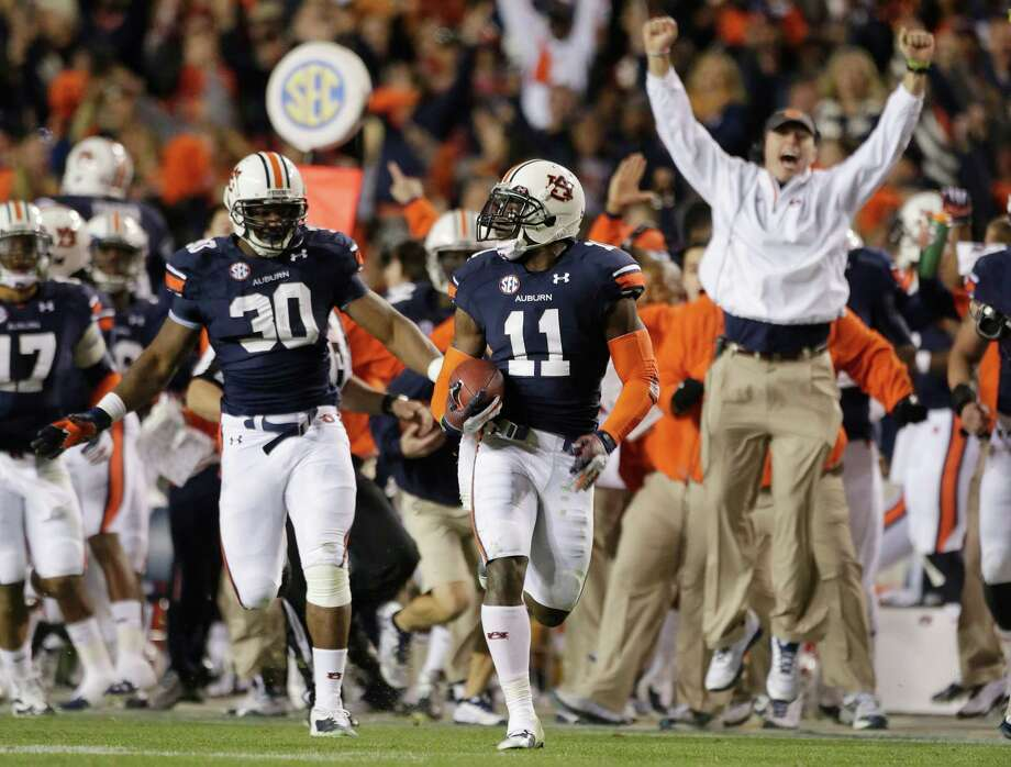Chris Davis (11) takes a 100-plus yard journey into Auburn lore to beat No. 1 Alabama. Photo: Dave Martin, STF / AP