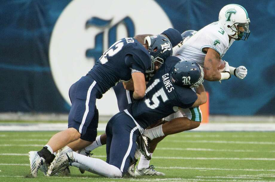 Tulane receiver Ryan Grant is going nowhere with Rice's Phillip Gaines (15) and Michael Kutzler combining on the tackle. Photo: Smiley N. Pool, Staff / © 2013  Houston Chronicle