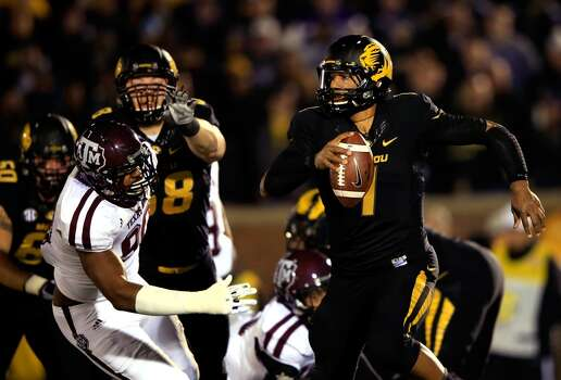 Missouri 28, Texas A&M 21Record: 8-4  Quarterback James Franklin #1 of Missouri scrambles as defensive lineman Polo Manukainiu #90 of the Aggies chases. Photo: Jamie Squire, Getty Images