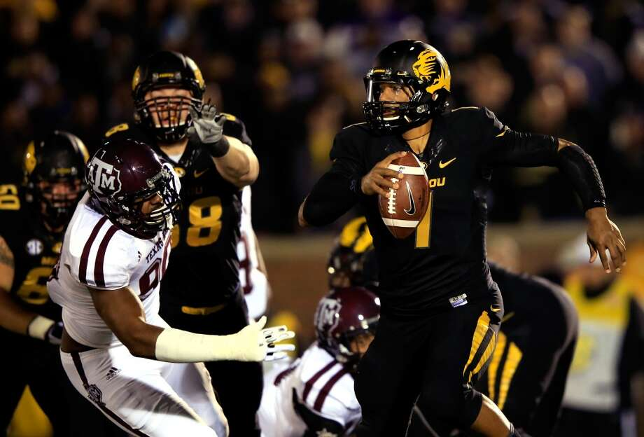 Missouri 28, Texas A&M 21Record: 8-4Quarterback James Franklin #1 of Missouri scrambles as defensive lineman Polo Manukainiu #90 of the Aggies chases. Photo: Jamie Squire, Getty Images
