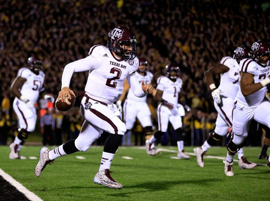 Quarterback Johnny Manziel #2 of the Texas A&M Aggies scrambles during the game against the Missouri Tigers on November 30, 2013 in Columbia, Missouri.  (Photo by Jamie Squire/Getty Images) Photo: Jamie Squire, Getty Images