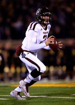 Quarterback Johnny Manziel #2 of the Aggies scrambles. Photo: Jamie Squire, Getty Images