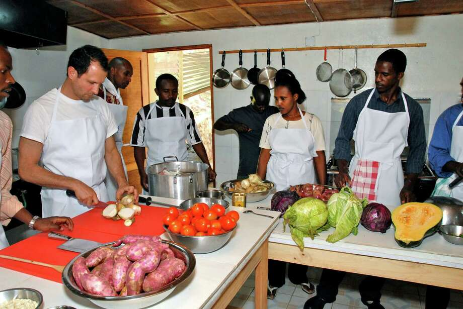 Kitchen training in Josh and Alissa Ruxin's restaurant, Heaven, in Rwanda. Photo: Contributed Photo / The News-Times Contributed