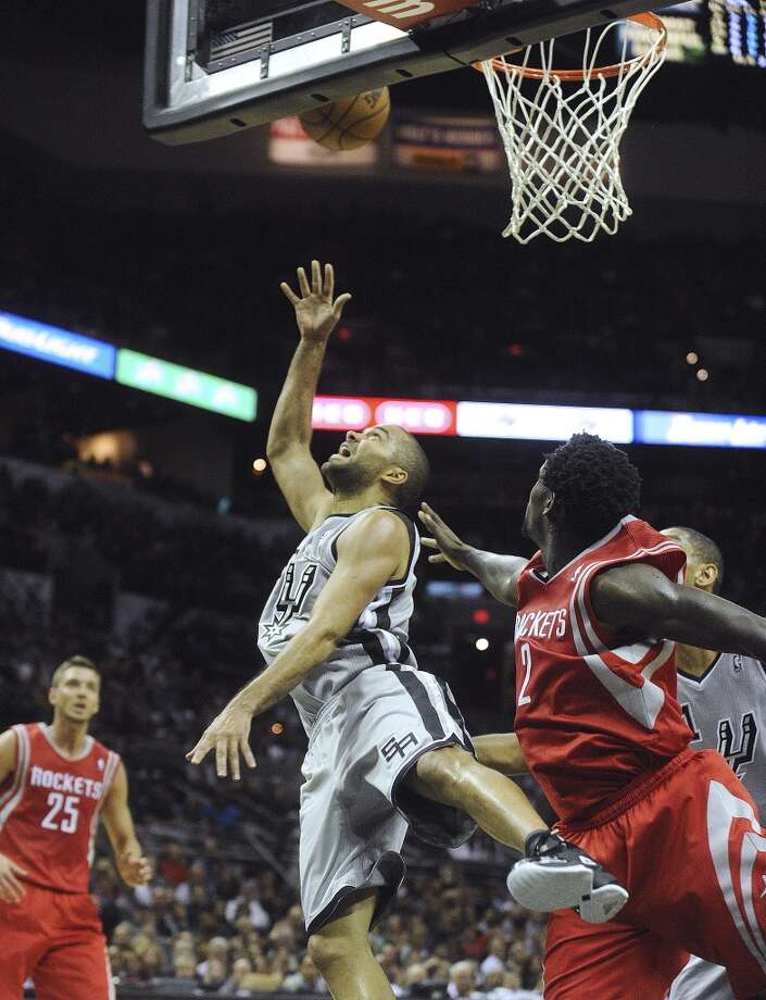 Tony Parker of the San Antonio Spurs shoots a reverse layup against the Houston Rockets during NBA action at the AT&T Center on Saturday, Nov. 30, 2013. Photo: Billy Calzada, San Antonio Express-News