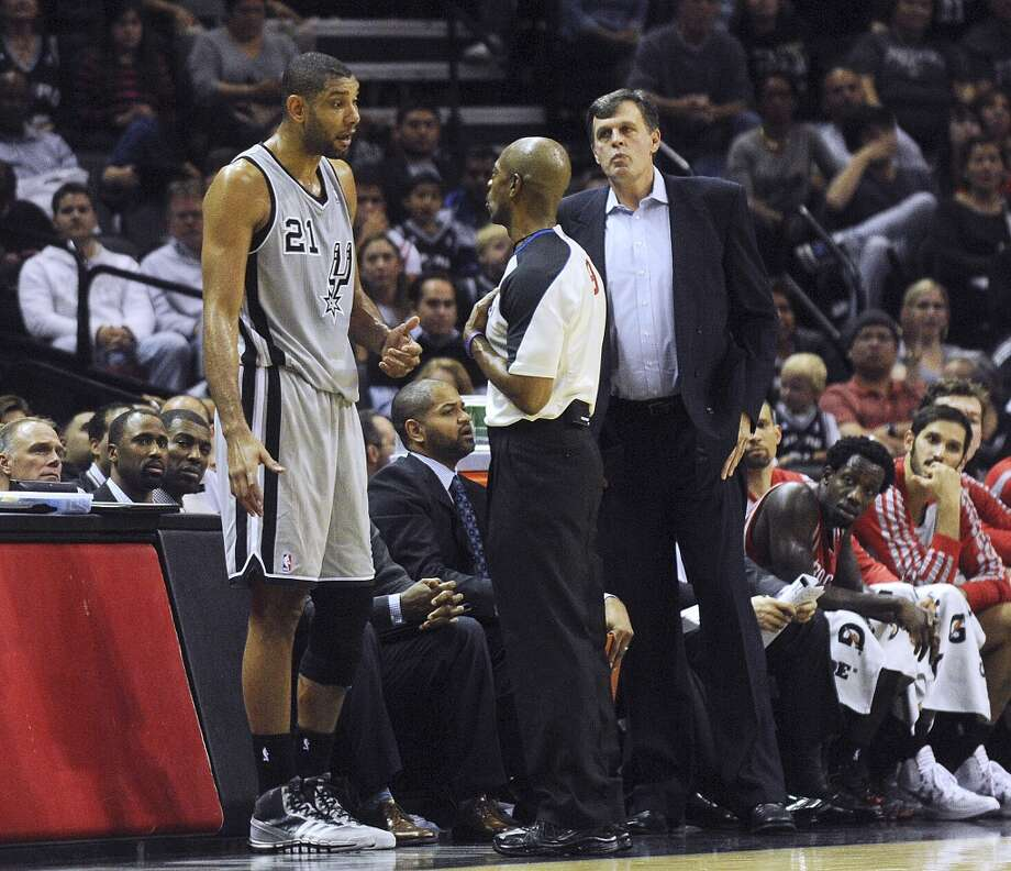 Tim Duncan of the Spurs complains to the official about the position of Houston Rockets coach Kevin McHale on the sideline as Duncan prepares to inbound a pass during NBA action at the AT&T Center on Saturday, Nov. 30, 2013. Photo: Billy Calzada, San Antonio Express-News