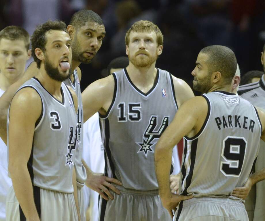 Marco Belinelli, left, Tim Duncan, Matt Bonner and Tony Parker catch their breaths during a timeout as time  winds down on their 112-106 loss to the Houston Rockets at the AT&T Center on Saturday, Nov. 30, 2013. Photo: Billy Calzada, San Antonio Express-News