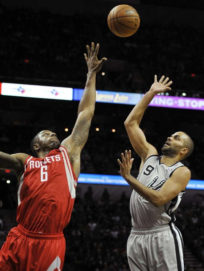San Antonio Spurs point guard Tony Parker, right, of France, shoots against Houston Rockets forward Terrence Jones during the first half of an NBA basketball game Saturday, Nov. 30, 2013, in San Antonio. Photo: Darren Abate, Associated Press