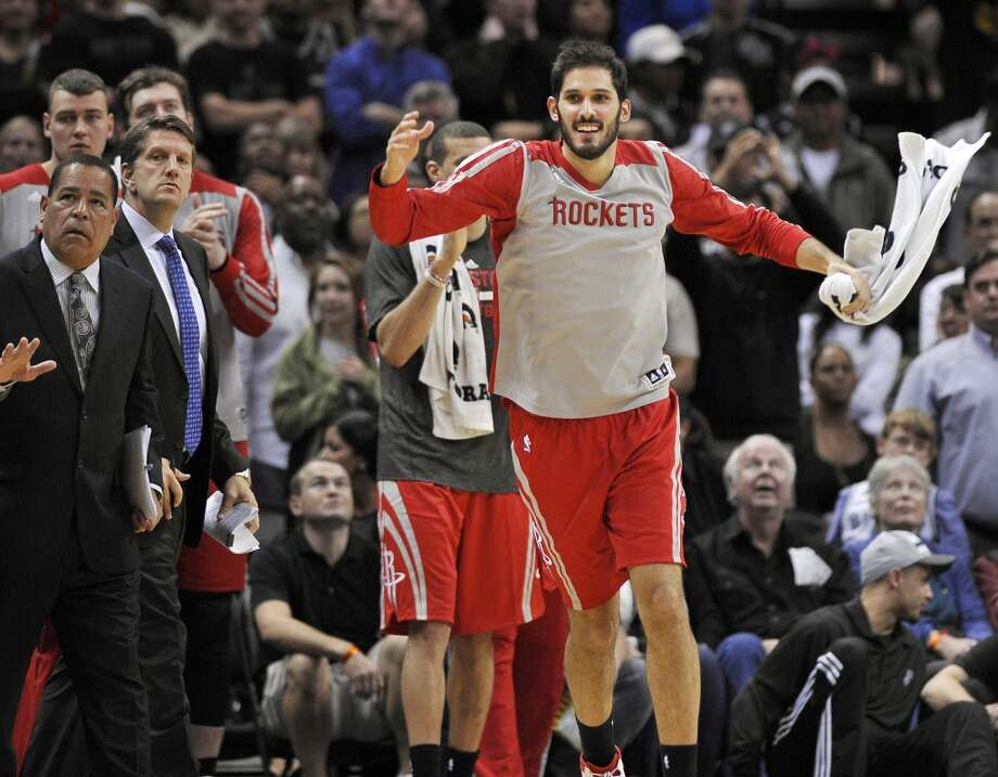 Houston Rockets small forward Omri Casspi, of Israel, celebrates on the Houston bench during the final seconds of an NBA basketball game against the San Antonio Spurs, Saturday, Nov. 30, 2013, in San Antonio. Houston won 112-106. Photo: Darren Abate, Associated Press