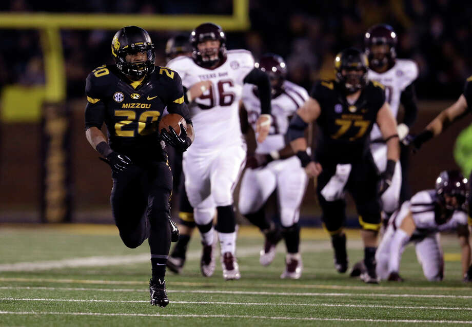 Missouri running back Henry Josey scores on a 57-yard touchdown run during the fourth quarter of an NCAA college football game against Texas A&M on Saturday, Nov. 30, 2013, in Columbia, Mo. (AP Photo/Jeff Roberson) Photo: Jeff Roberson, Associated Press / AP