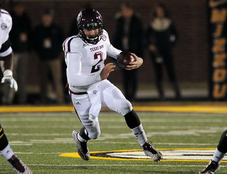 Texas A&M quarterback Johnny Manziel runs with the ball during the first quarter of an NCAA college football game against Missouri on Saturday, Nov. 30, 2013, in Columbia, Mo. (AP Photo/L.G. Patterson) Photo: Associated Press