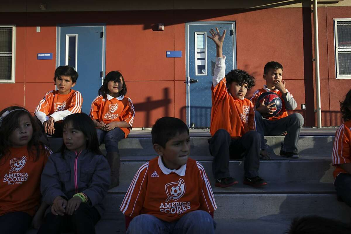 Children sit on steps during a free after-school program at Cleveland Elementary in San Francisco on November 22nd 2013.