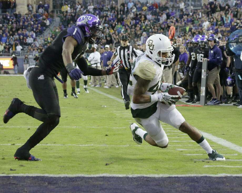 Baylor receiver Levi Norwood scores a touchdown in front of TCU safety Chris Hackett in the second half. Photo: LM Otero / Associated Press