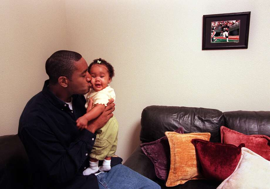 Corey Dillon is another well-known Franklin grad. The former NFL football star, who played with the Cincinnati Bengals and New England Patriots, is pictured in 1999, with his daughter Cameron, then five months old.  Photo: ROBIN LAYTON, P-I File