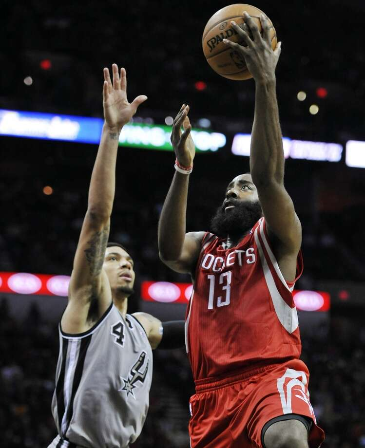 Rockets shooting guard James Harden, right, shoots against Spurs shooting guard Danny Green. Photo: Darren Abate, Associated Press