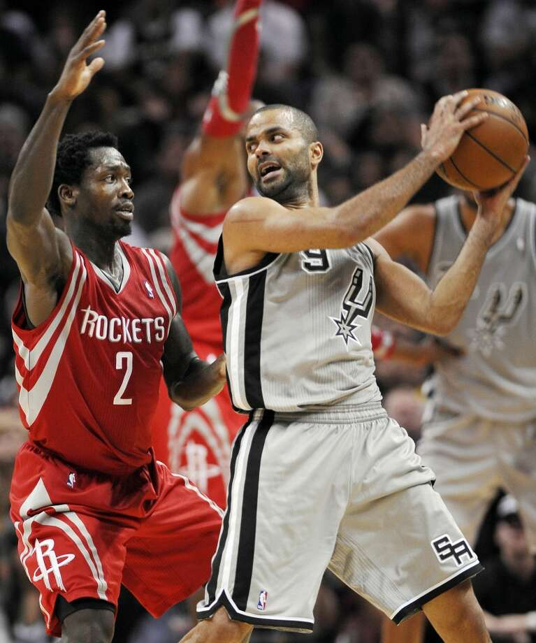 Rockets point guard Patrick Beverley, left, defends Spurs point guard Tony Parker. Photo: Darren Abate, Associated Press