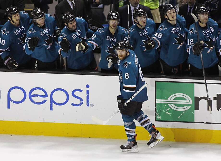 Joe Pavelski gets congratulations after scoring the loan goal in the shootout. Photo: George Nikitin, Associated Press