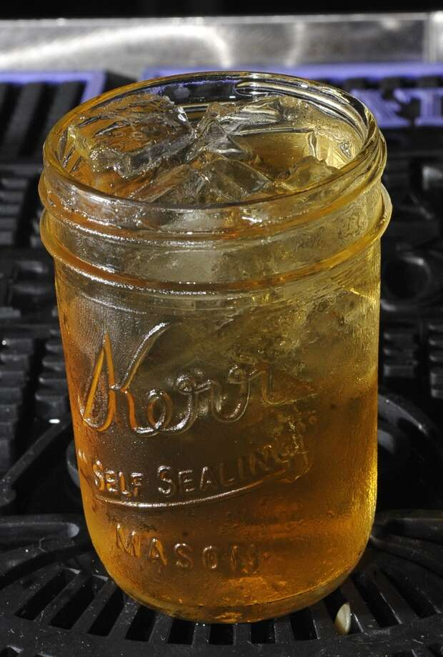 Tibideaux's is August 8, 2013 bar of the week.     This is an Apple Pie Moonshine drink.  Dave Ryan/The Enterprise Photo: Dave Ryan/The Enterprise
