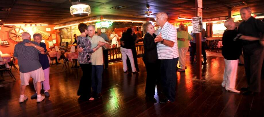 Patrons dance at Larry's French Market in Groves, Thursday October 6, 2011. Tammy McKinley/The Enterprise