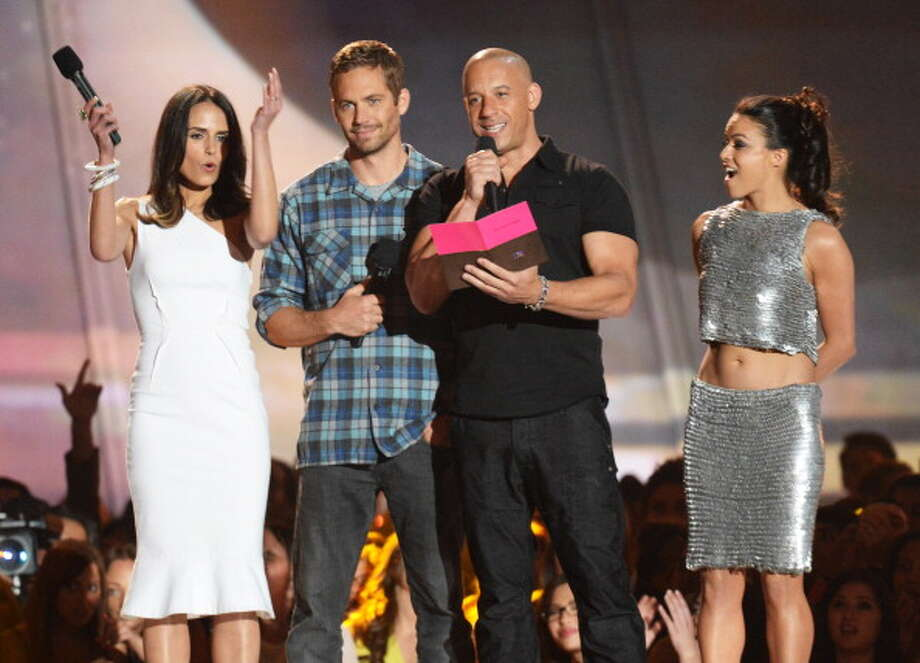 CULVER CITY, CA - APRIL 14:  (L-R) Actors Jordana Brewster, Paul Walker, Vin Diesel and Michelle Rodriguez speak onstage during the 2013 MTV Movie Awards at Sony Pictures Studios on April 14, 2013 in Culver City, California.  (Photo by Jeff Kravitz/FilmMagic) Photo: Jeff Kravitz, FilmMagic / 2013 Jeff Kravitz