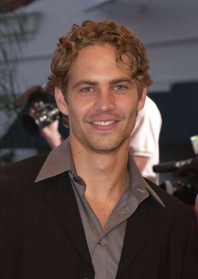 "Actor Paul Walker arrives at the world premiere of Universal Pictures'' ""The Fast and the Furious"" June 18, 2001 in Westwood, CA. (Photo by Getty Images) Photo: Getty Images / Getty Images North America"