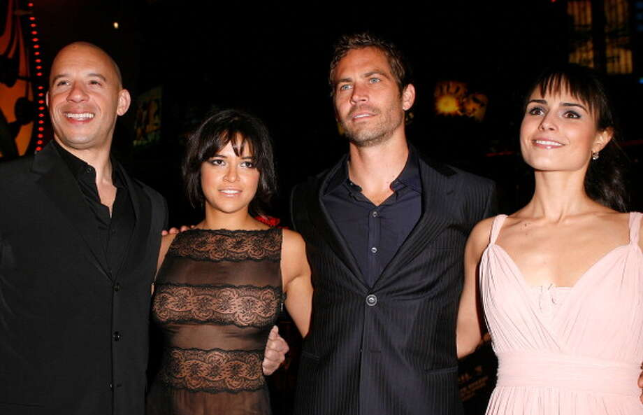 """Actors Vin Diesel, Michelle Rodriguez, Paul Walker and Jordana Brewster arrive on the red carpet of the Los Angeles premiere of """"Fast & Furious"""" held at the Gibson Amphitheatre on March 12, 2009 in Universal City, California. (Photo by Jeff Vespa/WireImage) Photo: Jeff Vespa, WireImage / 2009 Jeff Vespa"""