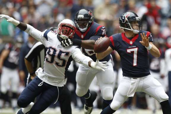 Texans quarterback Case Keenum (7) is pressured by New England Patriots defensive end Chandler Jones (95) as he throws a pass during the first quarter.