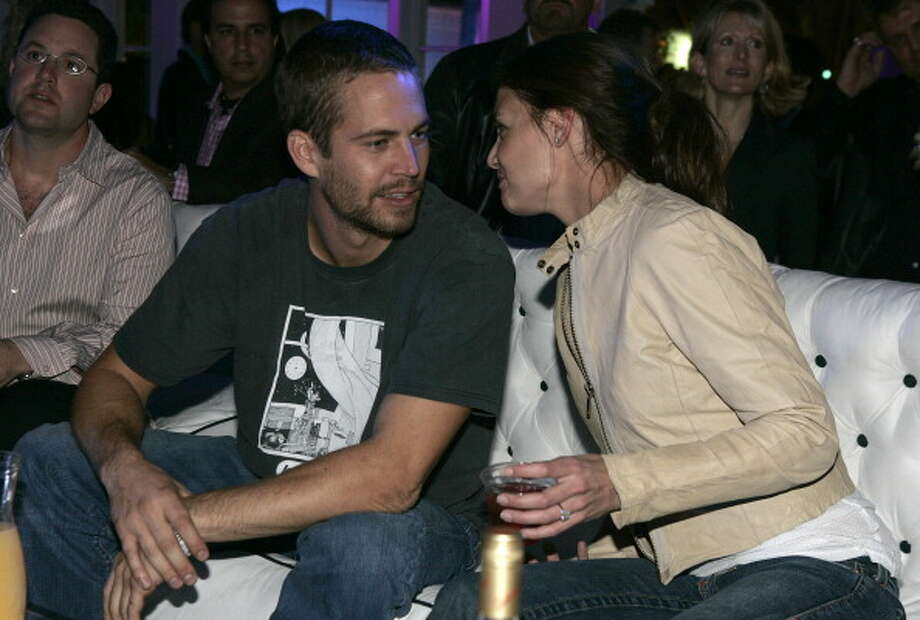 """Paul Walker and Katie Holmes during Super Bowl XXXIX - The """"Maximony"""" Super Ball Party - February 5, 2005 at The Garden Club in Jacksonville, Florida, United States. ***Exclusive*** (Photo by Chris Polk/FilmMagic) Photo: Chris Polk, FilmMagic / FilmMagic"""