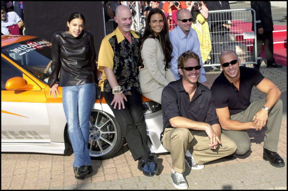 "FRANCE - SEPTEMBER 01:  Crew of the movie ""The fast and the fury"" at Deauville film festival in Deauville, France on September 01, 2001 - In the photo: Jordana Brewster, Michelle Rodriguez, Vin Diesel and Paul Walker.  (Photo by David LEFRANC/Gamma-Rapho via Getty Images) Photo: David LEFRANC, Gamma-Rapho Via Getty Images / 2011 Gamma-Rapho"