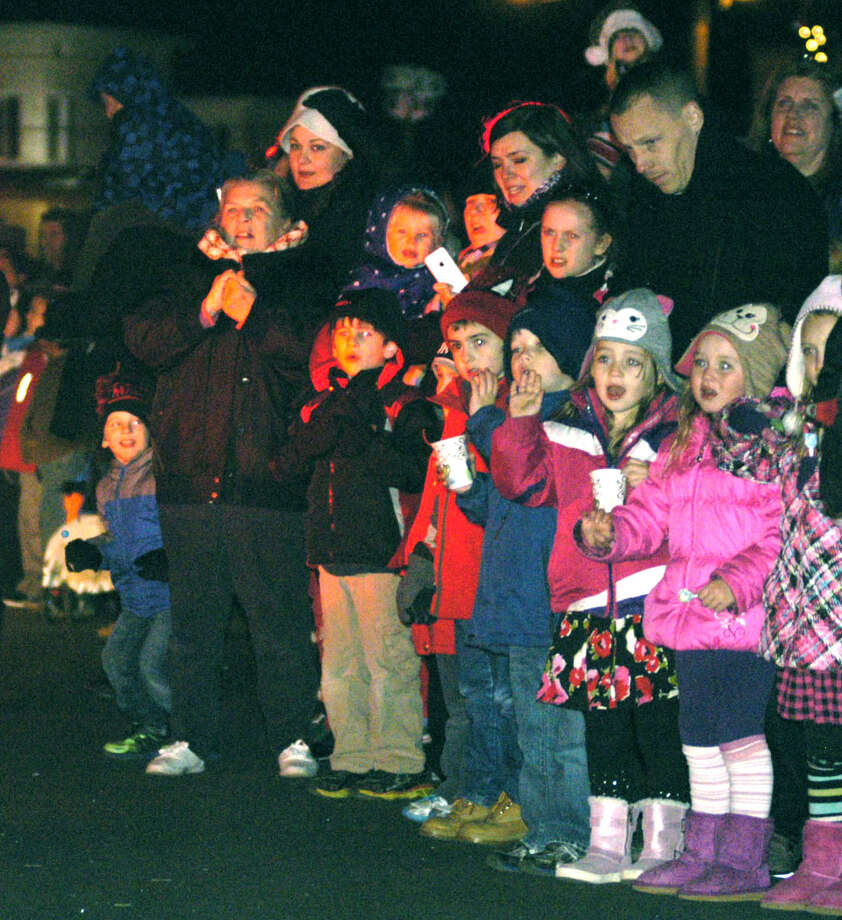 Hundreds line Main Street for the parade of lights provided by area fire departments Saturday, Nov. 30, 2013 along the New Milford Village Green during the Greater New Milford Chamber of Commerce's annual Festival of Lights. Photo: Norm Cummings / The News-Times
