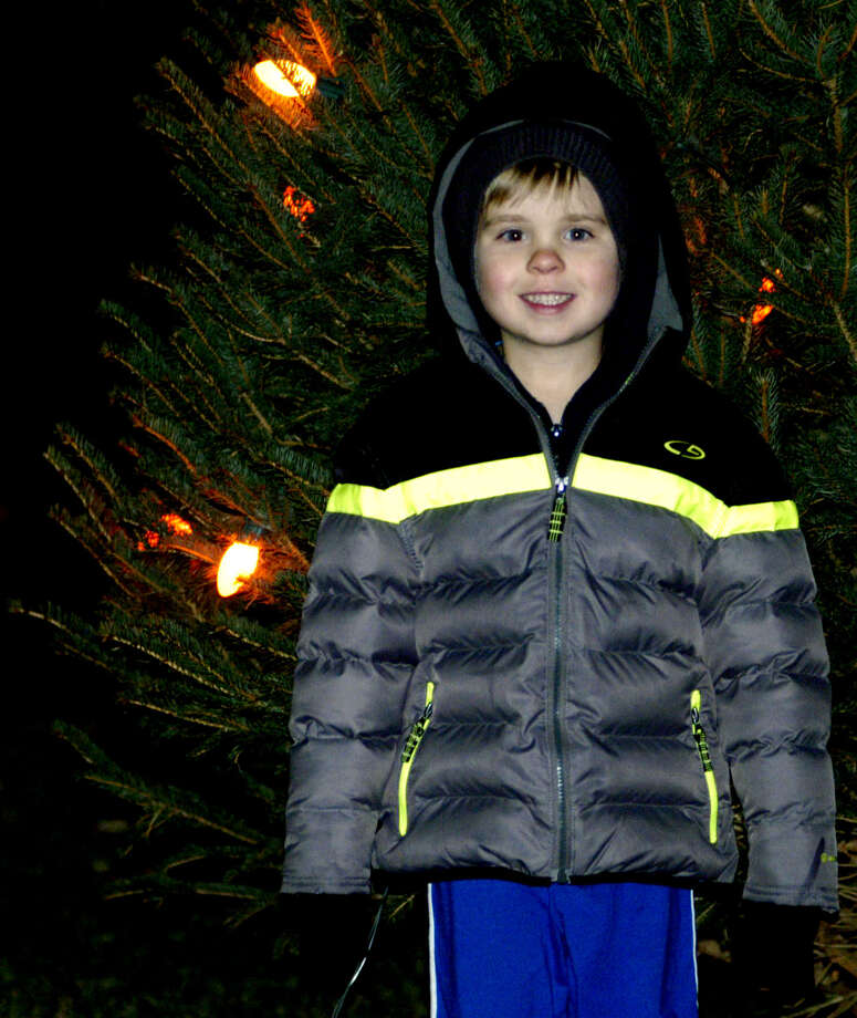 Nathaniel Dempster, 5, of New Milford happily poses for a family keepsake photo Saturday, Nov. 30, 2013 on the New Milford Village Green during the Greater New Milford Chamber of Commerce's annual Festival of Lights. Photo: Norm Cummings / The News-Times