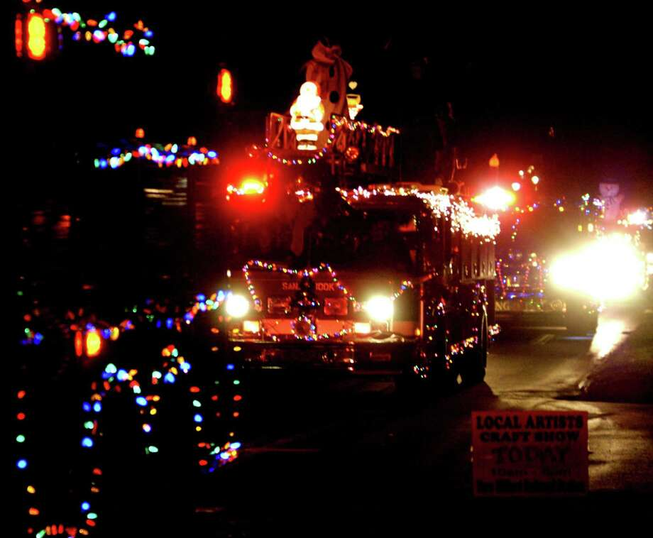 A parade of lights provided by area fire trucks prove a highlight Saturday, Nov. 30, 2013 along the New Milford Village Green during the Greater New Milford Chamber of Commerce's annual Festival of Lights. Photo: Norm Cummings / The News-Times