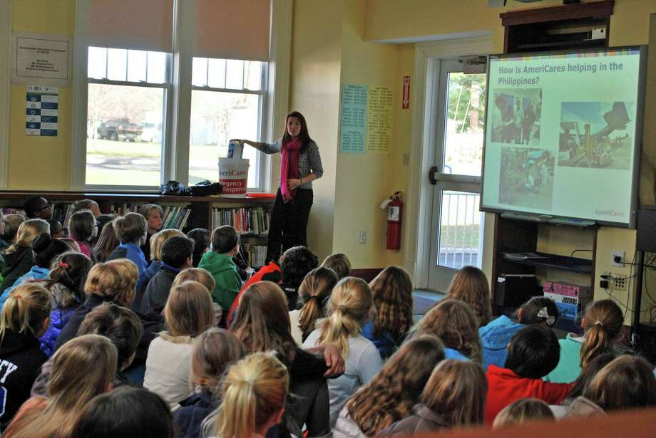 Lindsay O'Brien, AmeriCares' post-emergency response project manager, shares examples of its efforts with New Canaan Country School Middle and Upper School students as part of a service-learning partnership. Photo: Contributed Photo, Contributed / New Canaan News Contributed