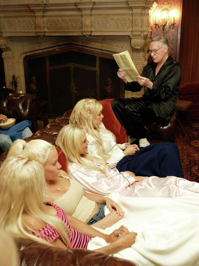 Hugh Hefner reads from his notes before a screening of Bonnie and Clyde at the Playboy Mansion June 18, 2004 in Los Angeles, California. Photo: Carlo Allegri, Getty Images / 2004 Getty Images