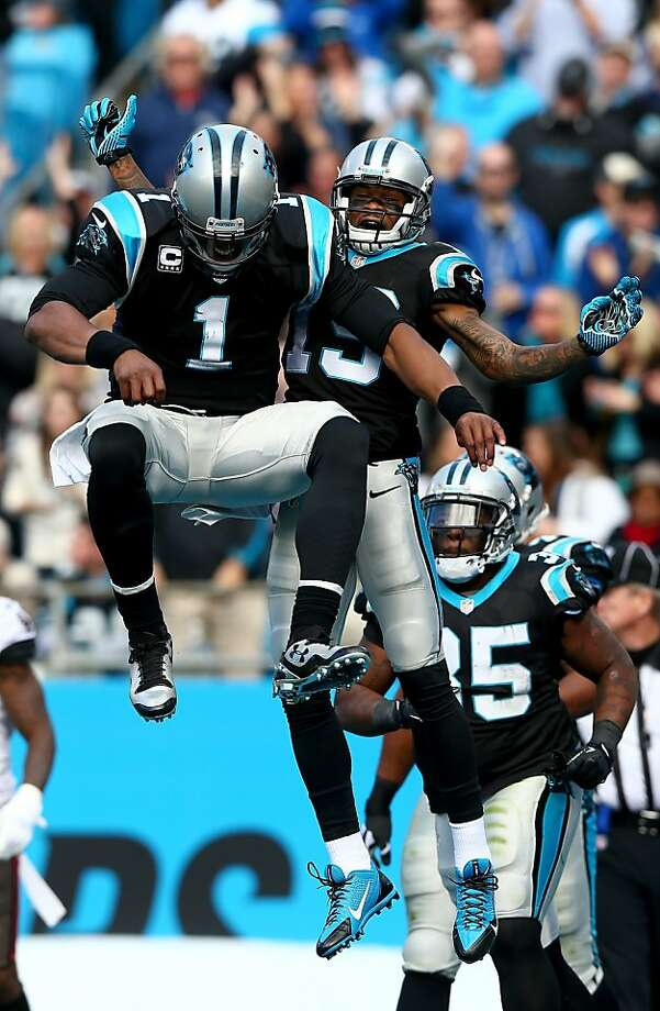 Quarterback Cam Newton celebrates in rarefied air with Ted Ginn (19) during Carolina's win Sunday. Photo: Streeter Lecka, Getty Images