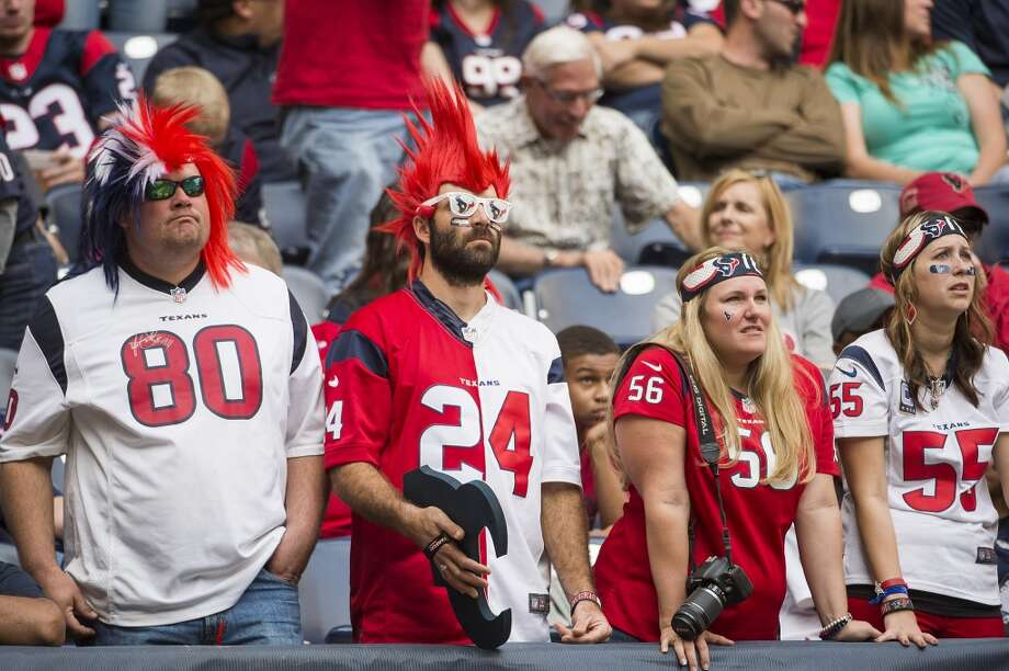 Texans fans react after the Patriots took a 34-31 lead late in the fourth quarter. Photo: Smiley N. Pool, Houston Chronicle