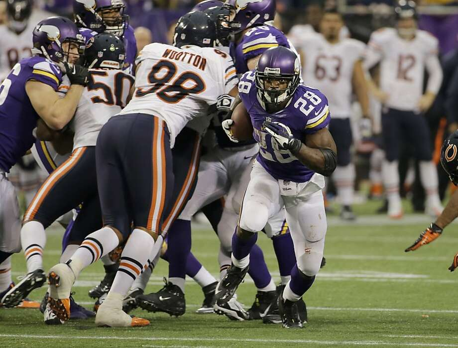 No longer held back by a nagging groin injury, the Vikings' Adrian Peterson (28) runs for some of his 211 yards, which included 51 on nine carries in overtime. Photo: Ann Heisenfelt, Associated Press