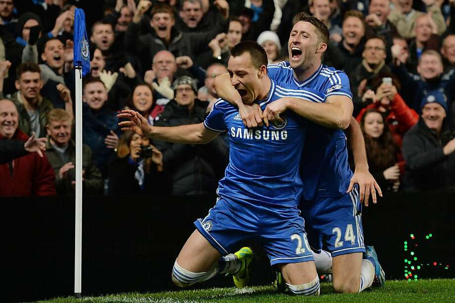 Chelsea's John Terry scored a goal in his 400th English Premier League game and celebrates with Graham Cahill. Photo: Ben Stansall, AFP/Getty Images